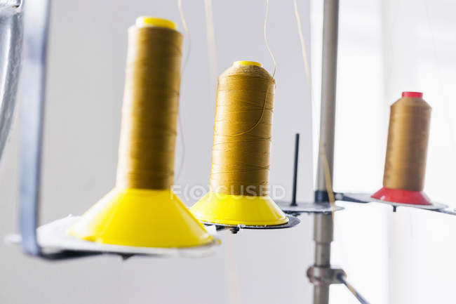 Golden thread spools — Stock Photo