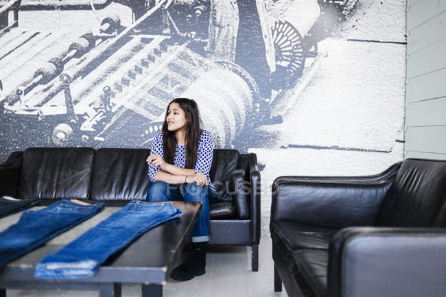 Female customer sitting on sofa — Stock Photo