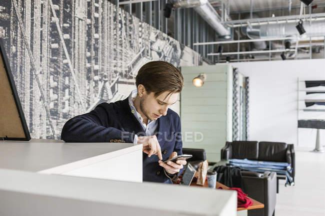 Salesman using mobile phone — Stock Photo