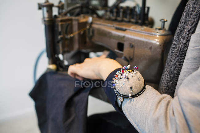 Fashion designer wearing pin cushion — Stock Photo