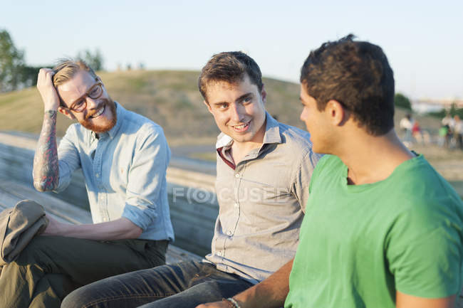 Friends communicating in park — Stock Photo