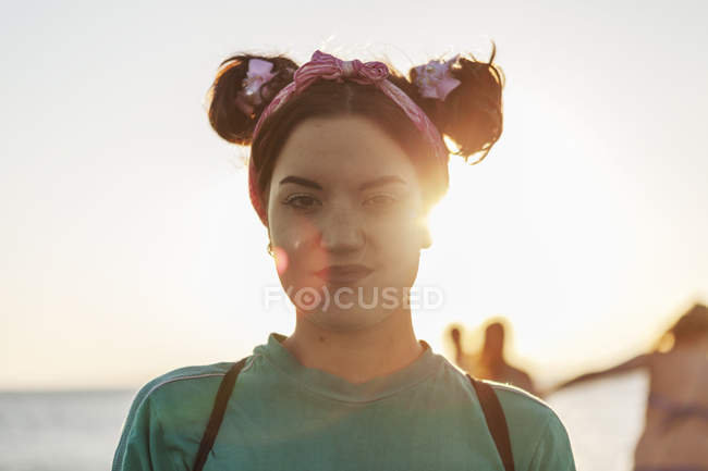 Confident young woman at beach — Stock Photo