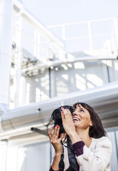 Happy woman photographing — Stock Photo
