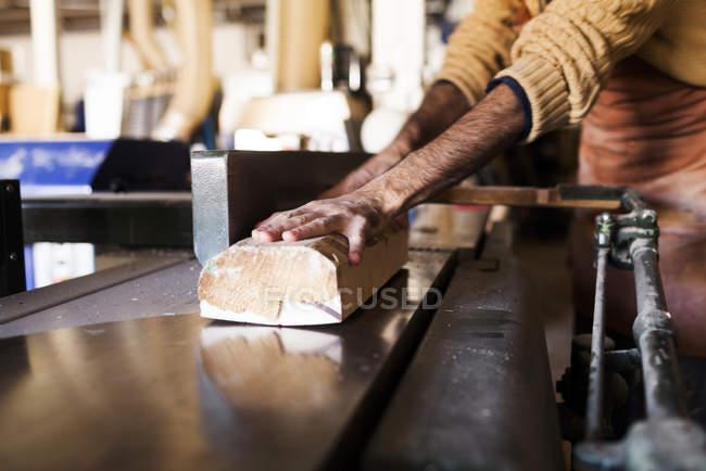 Carpenter using machine in workshop — Stock Photo