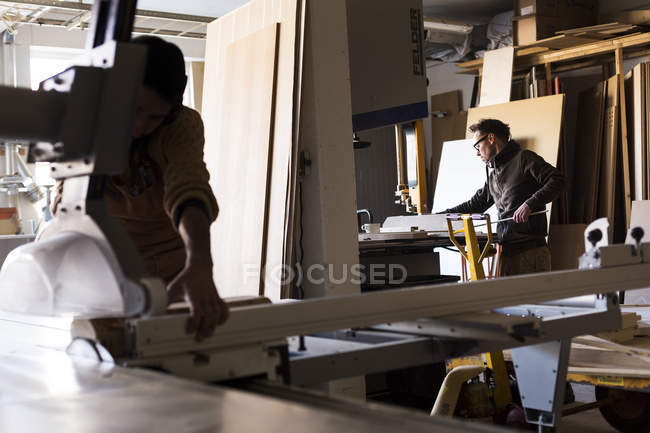 Carpenters working in workshop — Stock Photo