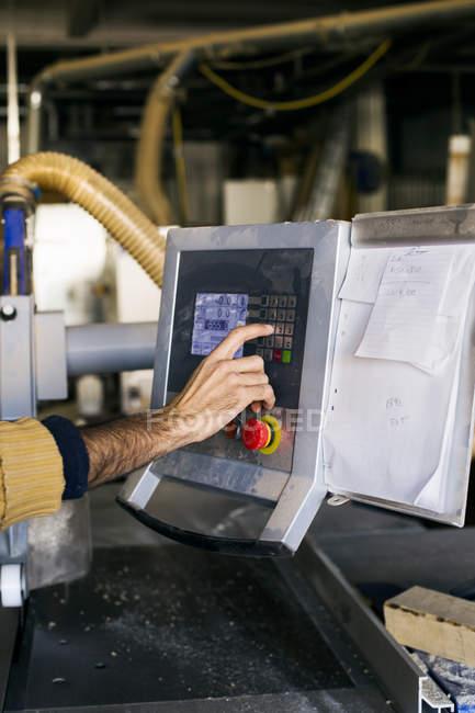Carpenter hand using monitor — Stock Photo