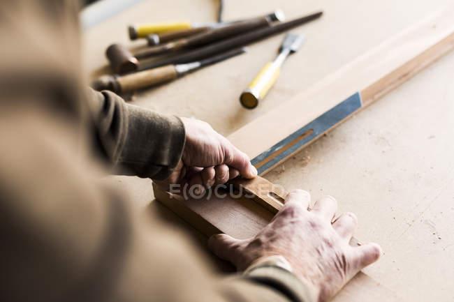 Carpenter using sliding T bevel — Stock Photo