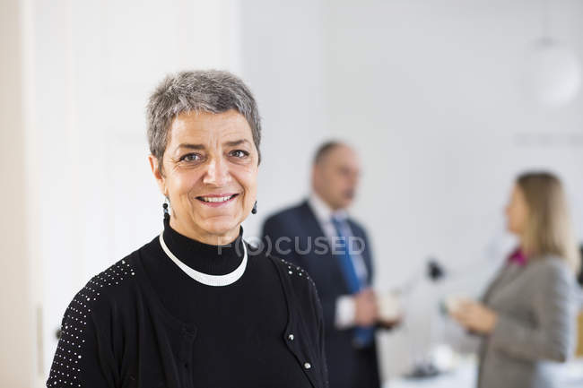 Portrait of businesswoman smiling — Stock Photo