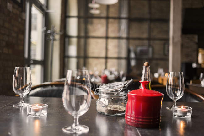Wine glasses and condiments on table — Stock Photo