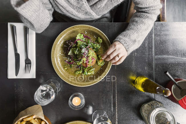 Woman with food served on table — Stock Photo
