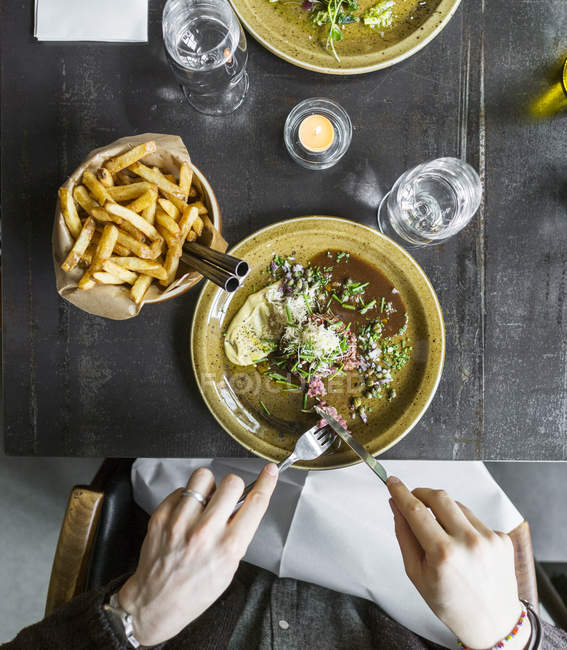 Man having food in restaurant — Stock Photo
