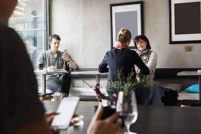 People sitting in restaurant — Stock Photo