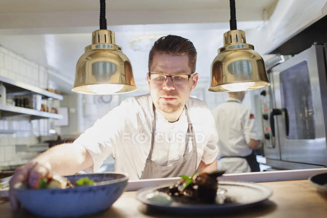 Chef keeping food bowl — Stock Photo