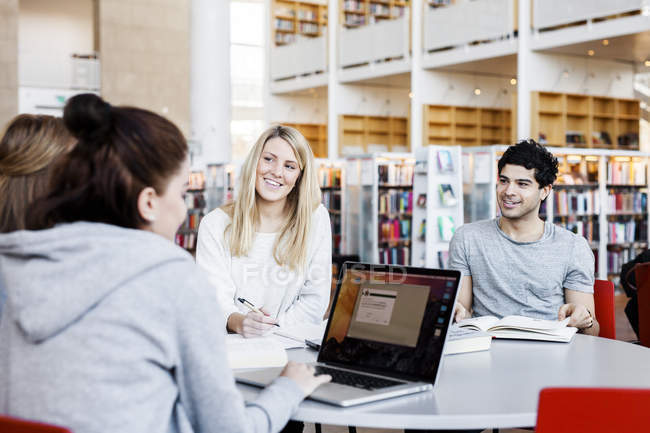 Happy friends discussing notes — Stock Photo