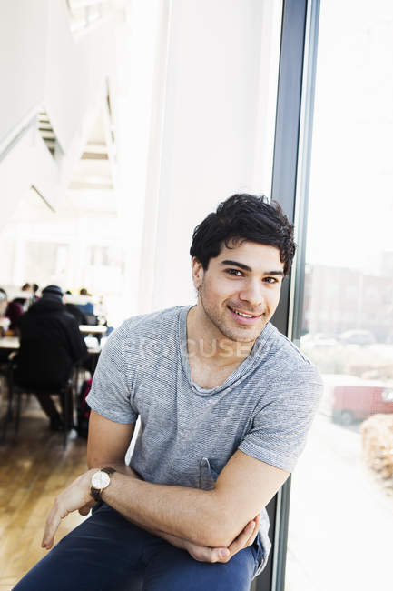 Happy man in library — Stock Photo