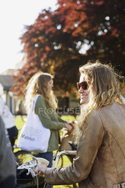 Happy woman with bicycle — Stock Photo