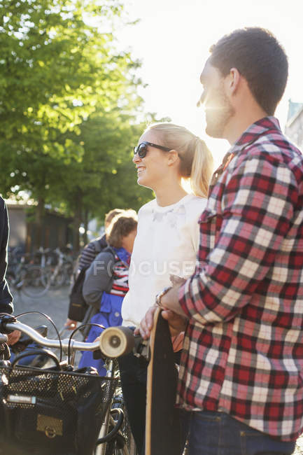 Friends with bicycle and skateboard — Stock Photo
