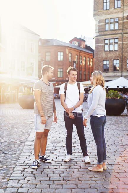Friends standing on street — Stock Photo
