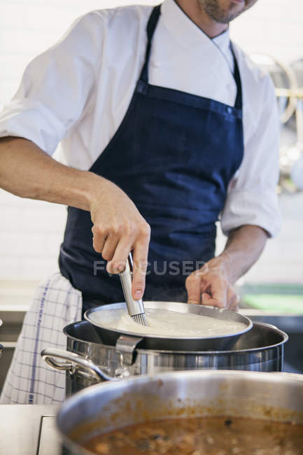 Chef whipping milk — Stock Photo