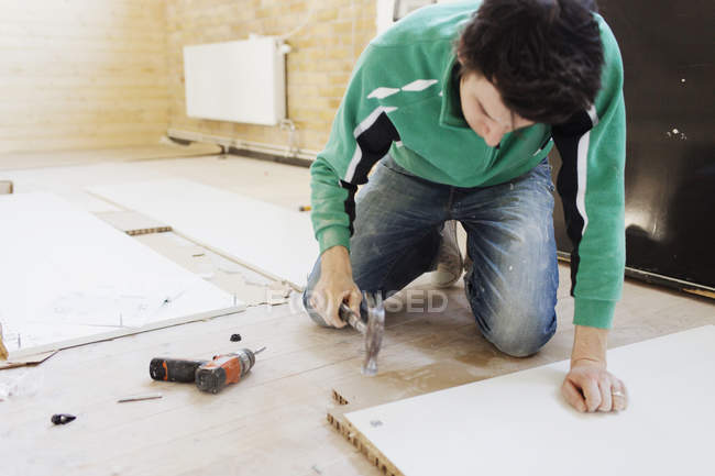 Carpenter working on wooden plank — Stock Photo