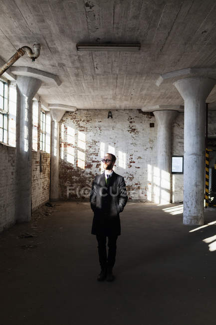 Lonely businessman in abandoned building — Stock Photo