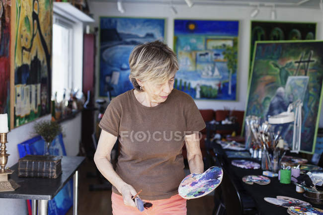 Senior female artist — Stock Photo