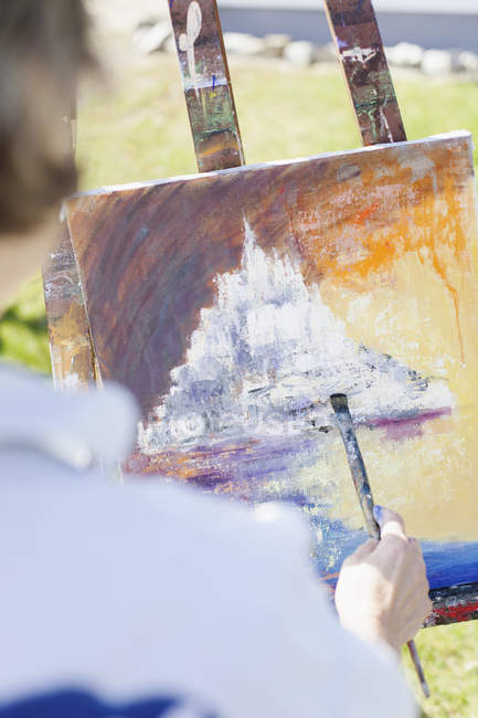 Senior female artist painting — Stock Photo