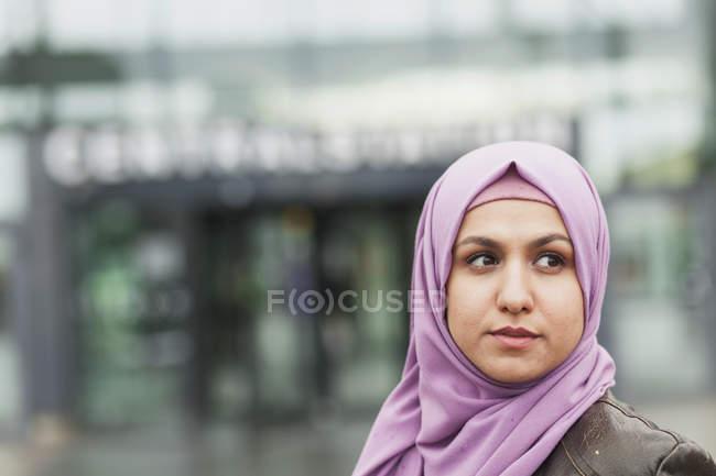 Thoughtful woman outside railroad station — Stock Photo