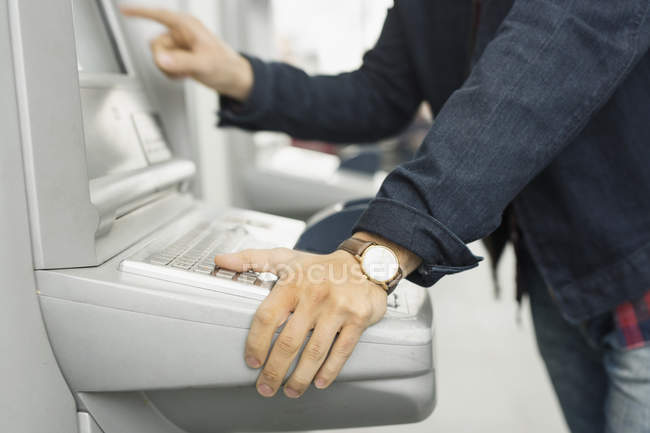 Man using ticket machine — Stock Photo