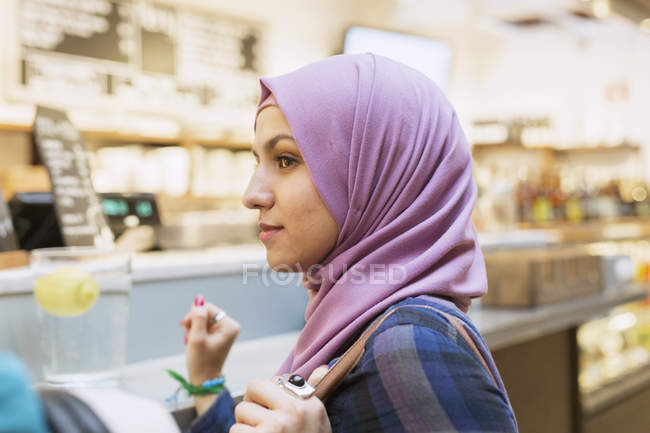 Young woman at railroad station — Stock Photo