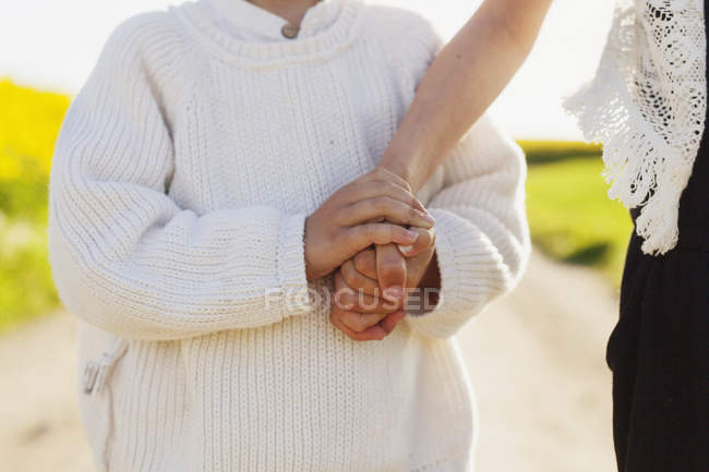Boy holding sister's hand — Stock Photo