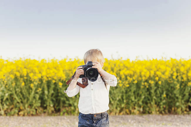 Boy photographing through camera — Stock Photo