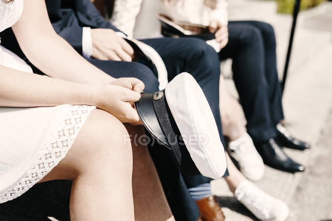 Students with caps sitting on steps — Stock Photo