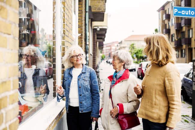 Senior women doing window shopping — Stock Photo