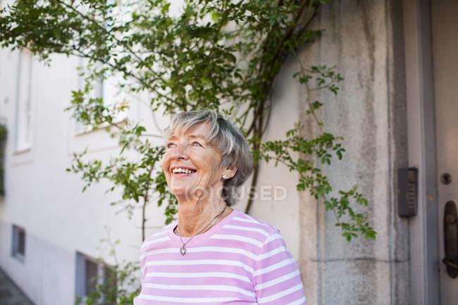 Senior woman smiling — Stock Photo