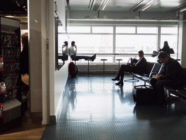 Businessmen waiting at airport — Stock Photo