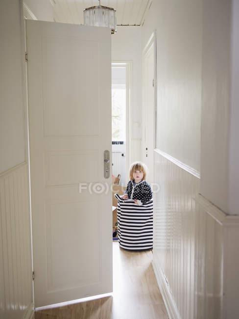 Girl standing in sack — Stock Photo