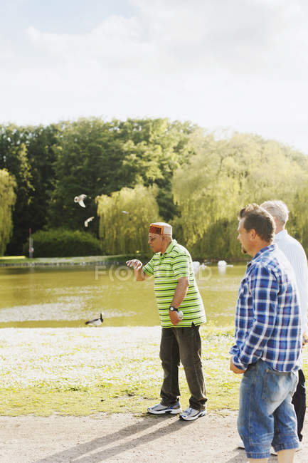 Male friends playing boule at park — Stock Photo
