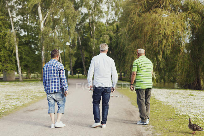 Rear view of friends playing boule — Stock Photo