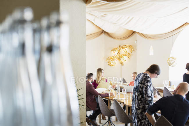 Friends and business in restaurant — Stock Photo