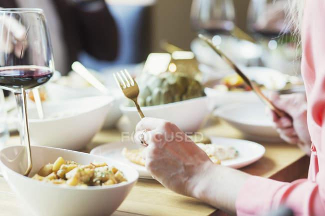 Woman tasting food in restaurant — Stock Photo