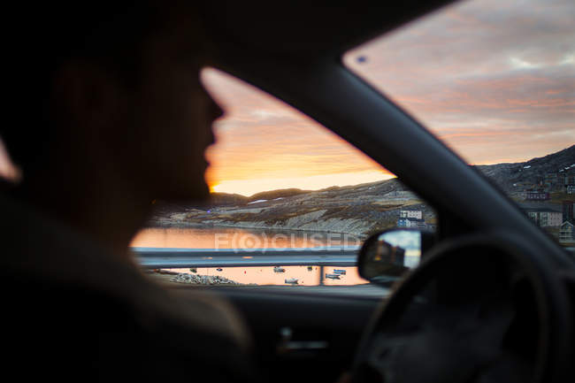 Man driving car with sea view — Stock Photo