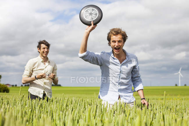 Two men with frisbee — Stock Photo