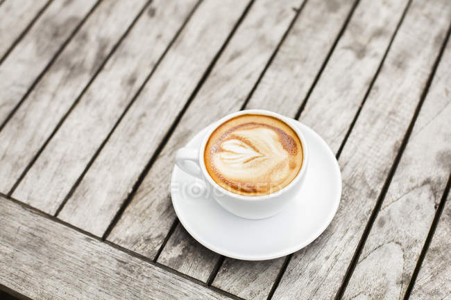 Cup of coffee with latte art — Stock Photo