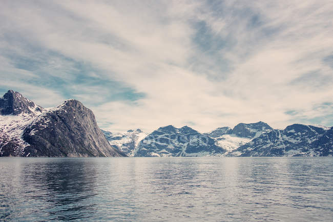Sea and snowcapped mountains — Stock Photo
