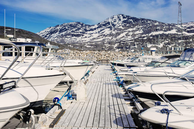 Boats moored by pier — Stock Photo