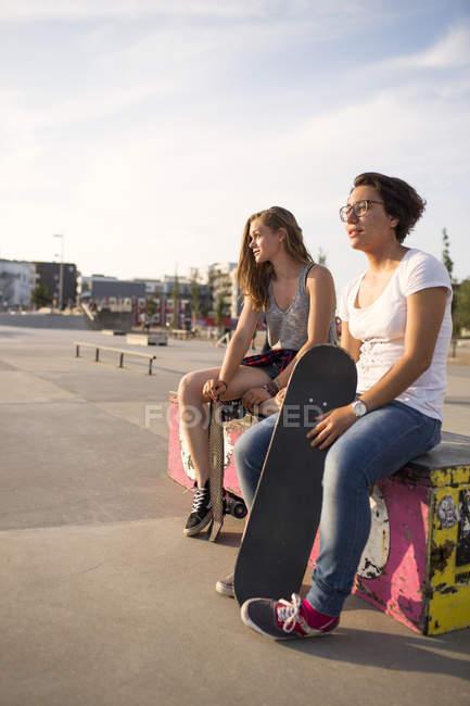Teenage girls with skateboards — Stock Photo