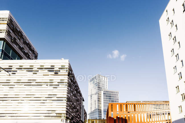 Modern city buildings against blue sky — Stock Photo