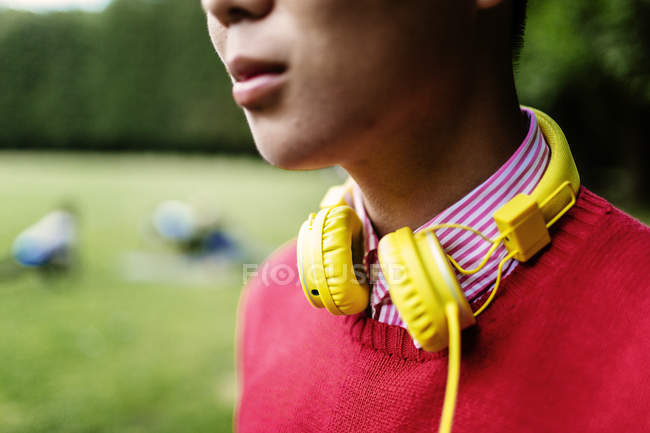 Young man with yellow headphones — Stock Photo
