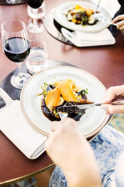 Woman having carrot mousse in restaurant — Stock Photo